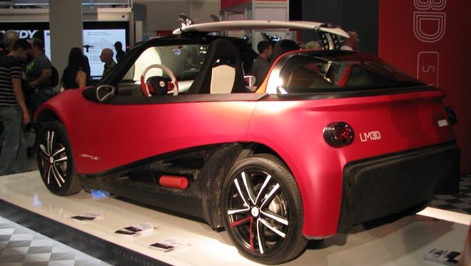 Local Motors hopes to start selling this surfer-inspired 3-D-printed car next year.