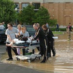 Patients are evacuated from Columbus Regional Hospital in Columbus, Ind. on June 7, 2008, due to flooding from severe weather.