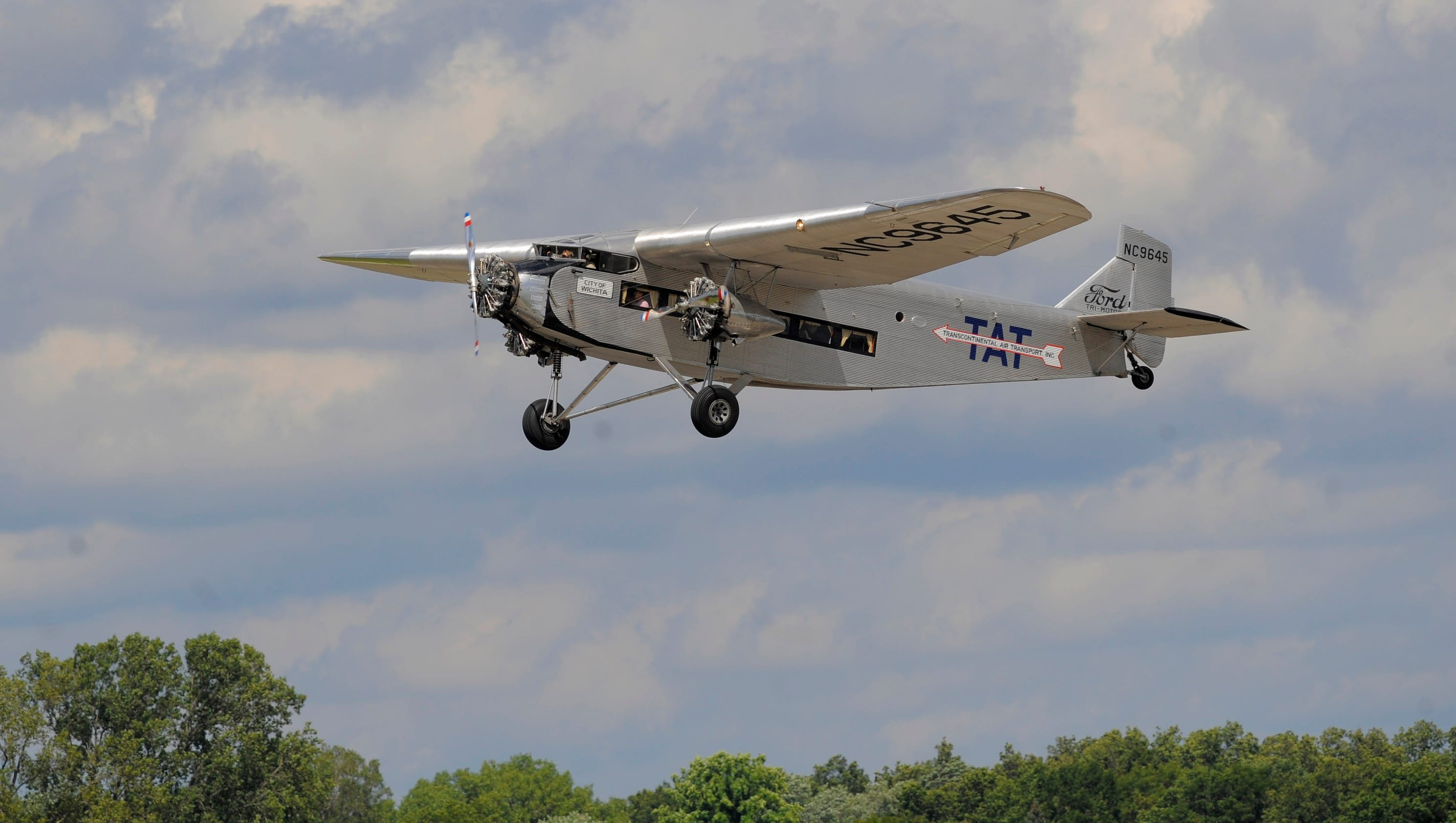 Fans Ride In 1928 Ford Tri Motor Airplane