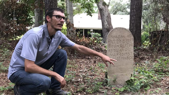 In early July, Richard Appleton shows a gravestone that was hand-etched at the cemetery.