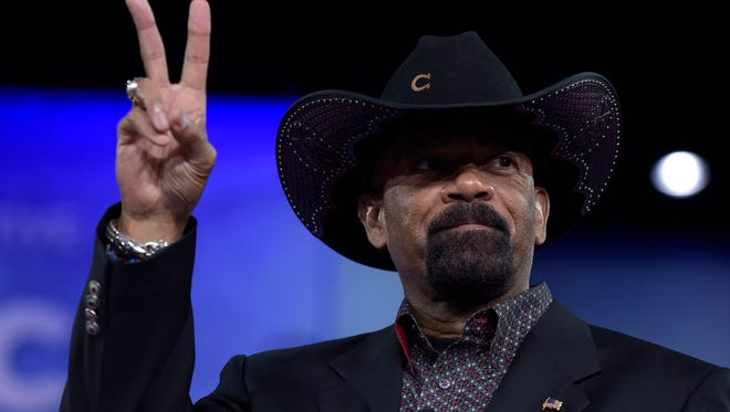 Milwaukee County Sheriff David A. Clarke Jr. gestures as he speaks at the Conservative Political Action Conference.