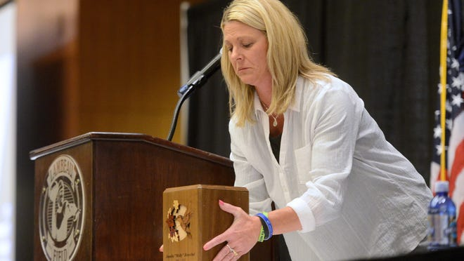 Bridgette Henschel brings out the urn of her daughter Amalia 'Molly' Henschel, who passed away in 2012 while sharing her story with the crowd at the 'It Doesn't Start With Heroin' Summit.