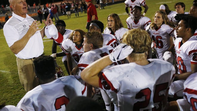 Winder-Barrow coach Ed Dudley speaks with his team after a game at Cedar Shoals two years ago..