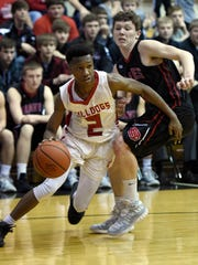 Bosse's Mekhi Lairy drives past Brownstown Central's