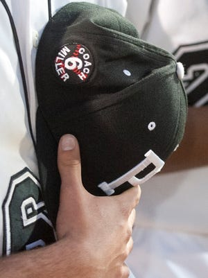 Pleasure Ridge Park baseball players honor the former head baseball coach of 39 years, Bill Miller, by placing his name on their baseball caps. Miller, who had also played for PRP as a youth, died April 23rd.