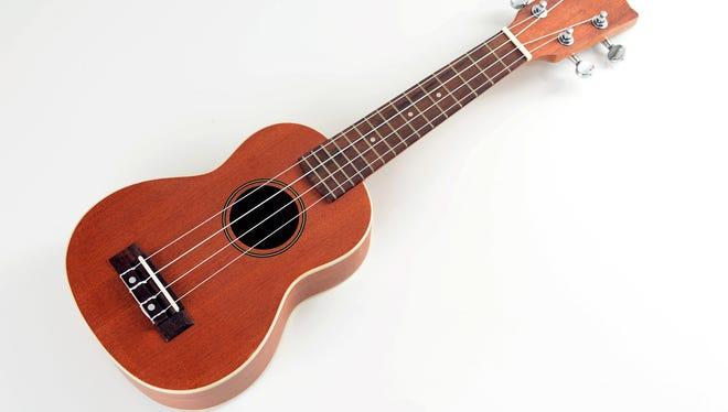 Picture of wooden ukulele on white background