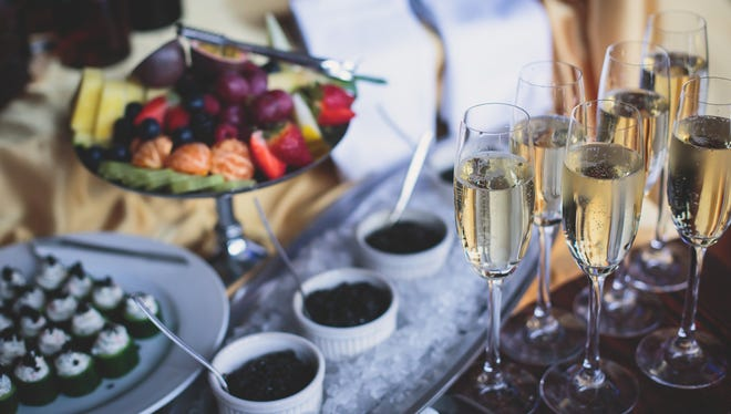 Holiday buffets are always tempting, but there are ways to avoid overdoing it.