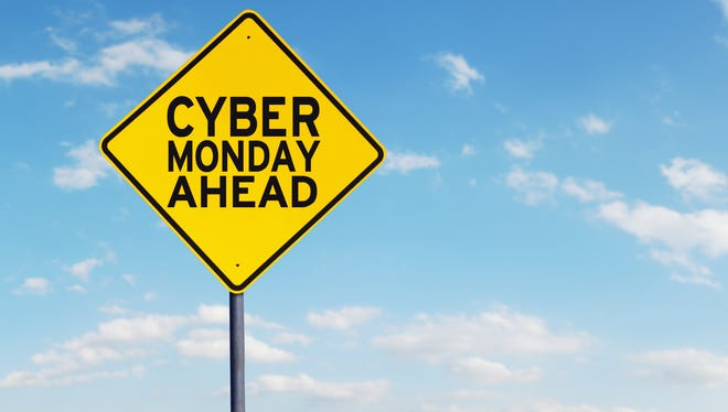 Picture of Cyber Monday text on a yellow road sign under blue sky
