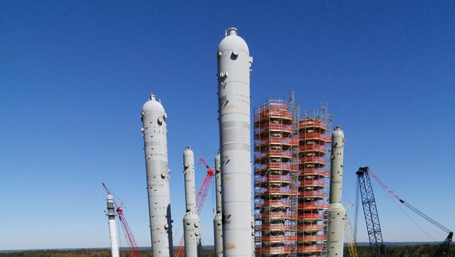 In this Nov. 13, 2012 photograph, the H2S and CO2 absorber vessels are undergoing construction at Mississippi Power's Kemper County energy facility near DeKalb, Miss.