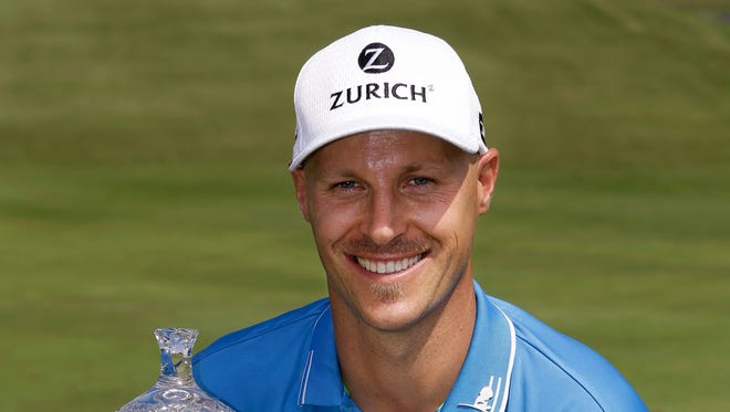 Ben Crane poses with his trophy after winning the St. Jude Classic golf tournament, Sunday, June 8, 2014, in Memphis, Tenn. Crane won the tournament with a score of 10-under 270. (AP Photo/Mark Humphrey)
