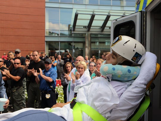 Medical staff, police officers and well-wishers applaud