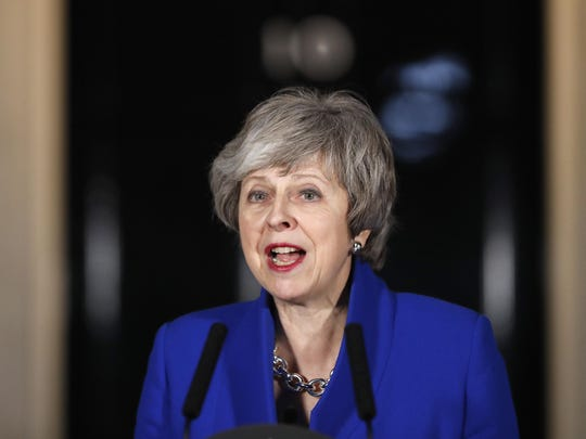 British Prime Minister Theresa May speaks outside 10 Downing street in London, Jan. 16, 2019. May's government survived a no-confidence vote Wednesday called after May's Brexit deal was overwhelmingly rejected by lawmakers.