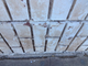 Peeling paint and cracked bricks and mortar are among