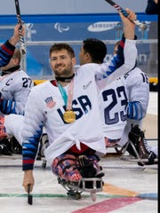 Travis Dodson celebrated his team gold medal with the U.S. Paralympic Sled Hockey Team in PyeongChang, South Korea..