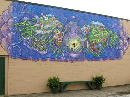 In this Oct. 1 photo, a mural covers the wall of a