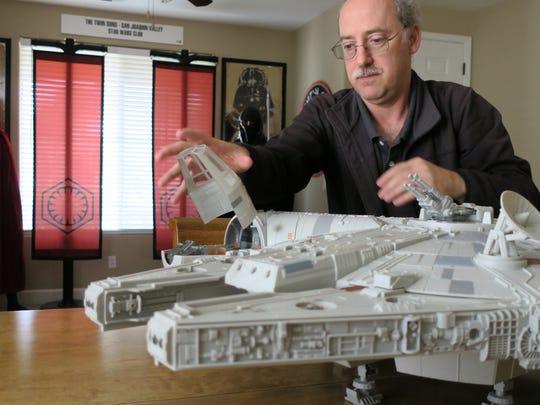 Star Wars enthusiast and collector Derek Mazer shows off his collectible Millennium Falcon.