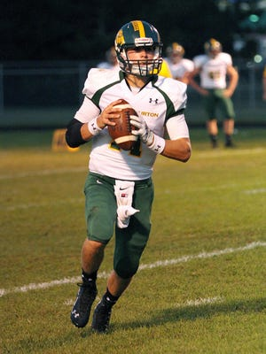 Burr and Burton quarterback Griff Stalcup rolls out of the pocket during a Week 3 football game against Milton.