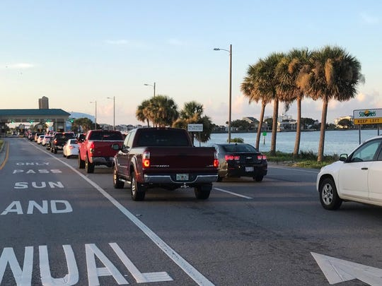Traffic backs up at the Bob Sikes Toll Bridge early Saturday, July 14, 2018, as huge crowds head to Pensacola Beach for the Blue Angels Air Show.