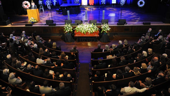Mourners and guests fill the auditorium at the funeral service for Grand Ole Opry member Jim Ed Brown at the Ryman Auditorium on Monday in Nashville.