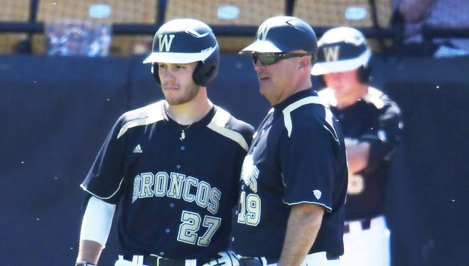 Billy Gernon talks to catcher Jesse Forestell earlier this season.
