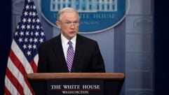 Attorney General Jeff Sessions responds to a question