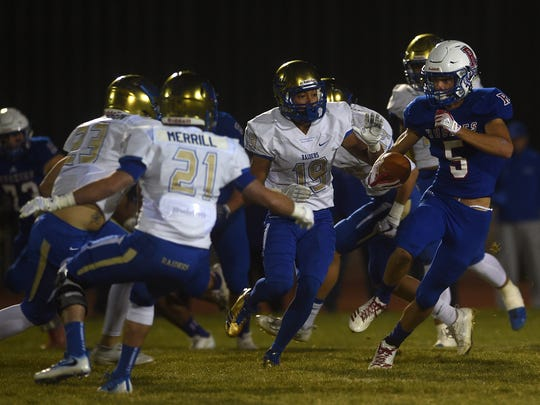 Reno's Ty Silver (5) runs while taking on Reed during their football game at Reno on Oct. 13.