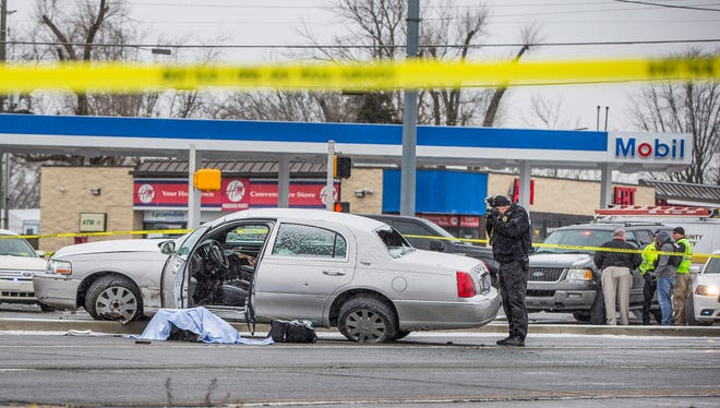 The scene of an officer-involved shooting Tuesday in Lawrence on Tuesday, Dec. 26, 2017. A business robbery was reported around 12:40 p.m. in the 8800 block of Pendleton Pike. The incident led to a pursuit, which ended near 42nd Street and Post Road. Police say the suspect carjacked someone. Police say the suspect fired at them, and a Lawrence police officer returned fire and struck the suspect. The suspect died at the scene. No officers were injured in the incident.