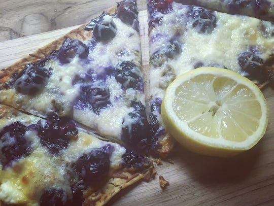 Slices of blueberry ricotta pizza.