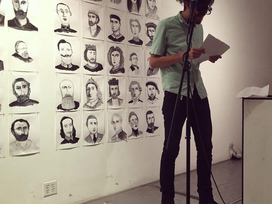 Akbar reading his poetry in Brooklyn in November.