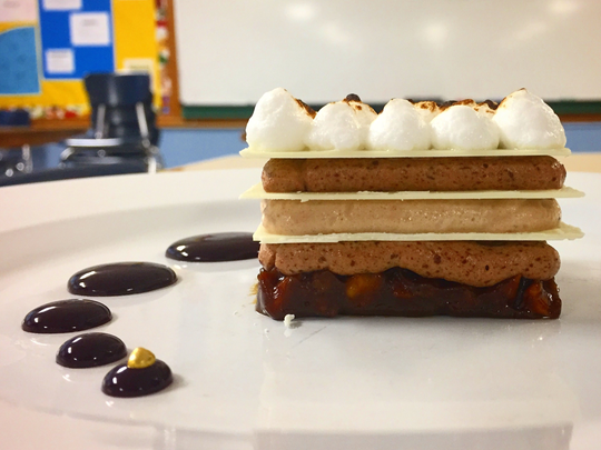 On the menu for the South Salem High School culinary team is layered chocolate mousse with orange-infused white chocolate and Marionberry sauce.