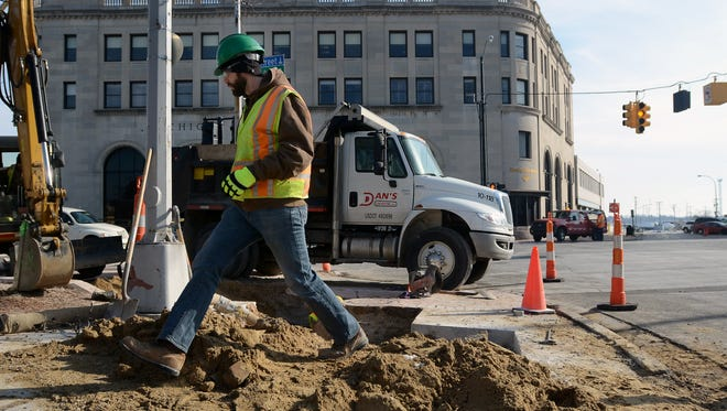 MDOT area soil engineer Chris James walks the site Monday, Jan. 25, at the intersection of Water and Military Streets in Port Huron.