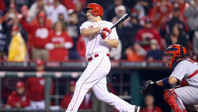 Chris Heisey of the Cincinnati Reds hits a game-winning single against the St. Louis Cardinals at Great American Ball Park in Cincinnati, Ohio.