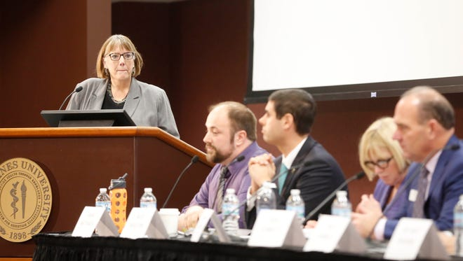 Moderator Kathie Obradovich listens as candidates for governor answer questions Tuesday, Dec. 5, 2017, during the Register's mental health forum at Des Moines University.