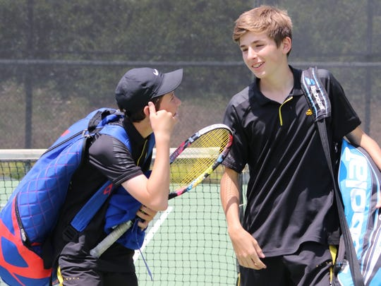 Noah Laber, left, and Francisco Antognetti clinched the winning point in doubles to help Ventura High beat Troy 14-4 in the CIF-SS Division 3 boys tennis final Friday at the Claremont Club.