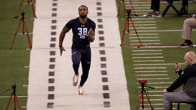 Memphis defensive back Arthur Maulet runs the 40-yard dash at the NFL football scouting combine Monday, March 6, 2017, in Indianapolis.