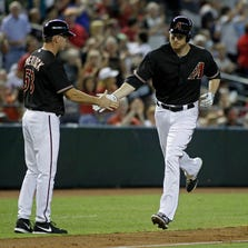 PHOENIX, AZ - AUGUST 09:  Mark Trumbo #15 of the Arizona Diamondbacks (R) is congratulated by third base coach Glenn Sherlock #53 after his three-run home run against the Colorado Rockies during the third inning of a MLB game at Chase Field on August 9, 2014 in Phoenix, Arizona.  (Photo by Ralph Freso/Getty Images)