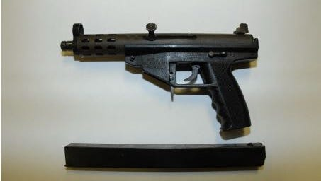"Gunsimilar to a ""Tech 9-mm"" recovered from BP Duke Station aggravated robbbery Thursday night."