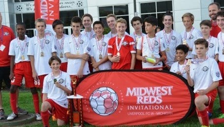 """The under-15 Farmington Fury boys soccer team won the Gold Division championship at the Midwest Reds Invitational Sept. 16-18.  The team consists of (back row, left to right) head coach Jeff  Blair, Terrence Bartell, Daniel Hanus, Martin Marks, Ryan Miklus, Jake Michalski, Nick Callcut, Max Marquette, John Lentz, Yousif Hani, Kyle Arnold, Joey Bass, Cameron Ignasiak, Joseph Katz, assistant coach Mike Bride, (front row, left to right), Daniel Bass, Pranav Narayanan and Eli Bride. The Fury went 4-0 and allowed only one goal in the four games.  """"It was a great experience for the boys. Coach Bride and I are very proud of their accomplishment,"""" Blair said."""