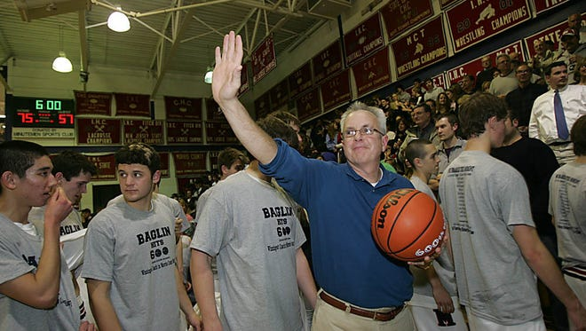 Daily Record file photo Mendham coach Jim Baglin salutes the fans as he leaves the gym after attaining his 600th career victory in 2009.