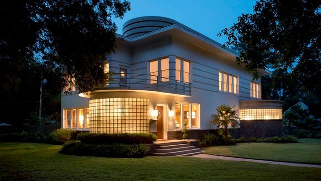 This South Highlands home is constructed in the streamline moderne style of the 1930s, which emphasized curving forms, long horizontal lines, and sometimes nautical elements.