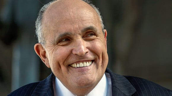 Former New York City Mayor Rudy Giuliani speaks at a press conference in 2014.