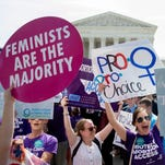 Pro-choice supporters celebrate outside the Supreme Court after the court's ruling.