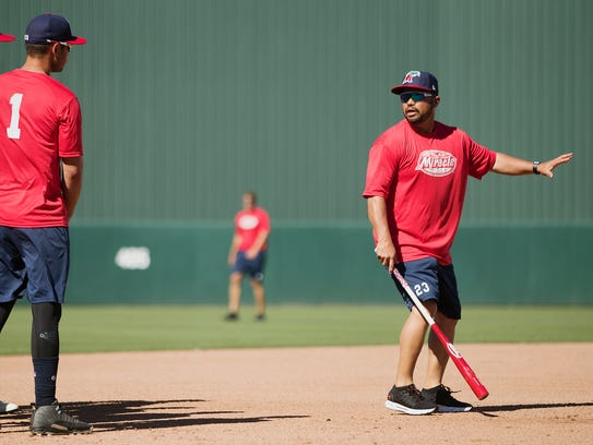 The Fort Myers Miracle manager Ramon Borrego, right,