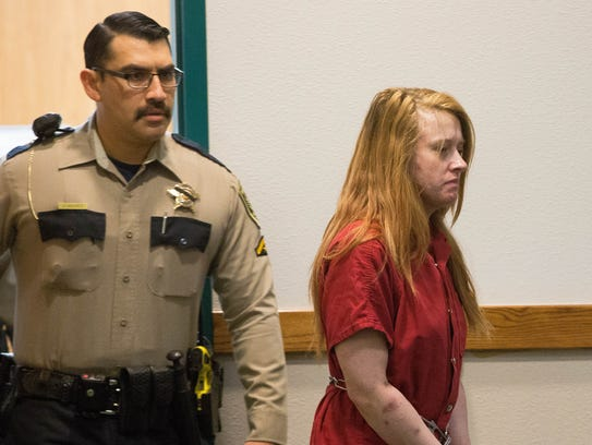 Trista Schlaefli, one of the suspects in a car chase that killed retired Las Cruces Police Officer J.R. Stewart, walks into the 3rd Judicial District Court. Friday Dec. 1, 2017, where she and Daniel Lowell the other suspect in the incident, were ordered to be held without bond pending trail.