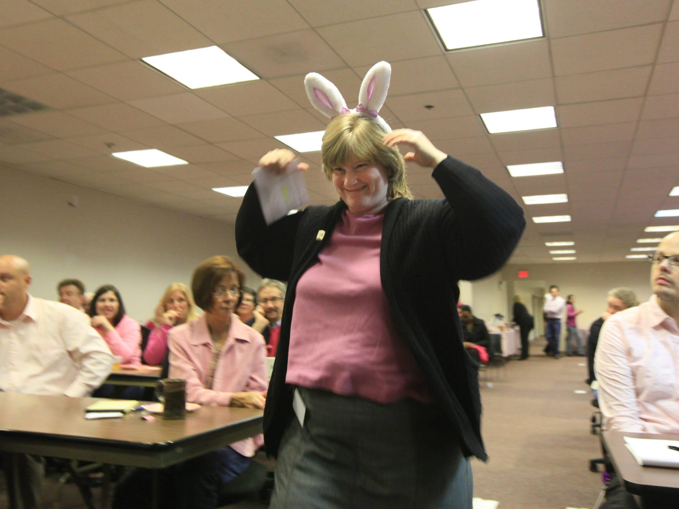 Merri Bayard, relocation accountant,  prepares to speak