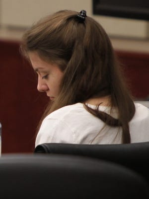 Shayna Hubers, charged with murder in the shooting death of Ryan Poston, listens to the testimony of a forensic pathologist during her trial.