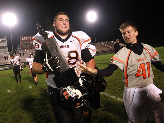 Ames won the first non-district meeting against Iowa City High for the Little Cy-Little Hawk trophy in 2014.