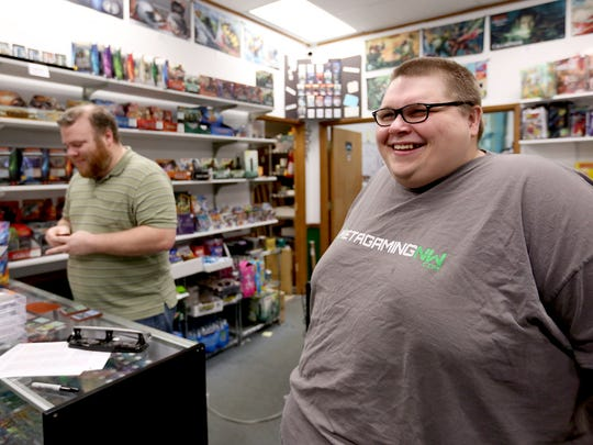 Ben Mathies, right, the co-owner of Meta-Gaming, and Jared Mulcare, the manager, in Salem on Thursday, Jan. 7, 2016.