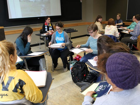 """University of Iowa students break into groups in Anna Barker's """"Wonder Woman Unleashed: A Hero for Our Times"""" course at the Adler Journalism Building on Thursday, March 3, 2016."""
