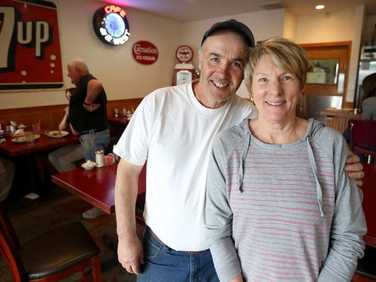 Cafe 22 owners Clyde and Cindy Aspinwall pose at Cafe 22 between Salem and Dallas on Highway 22.